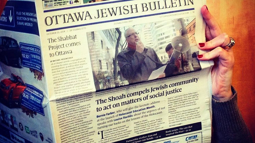 Newspaper reader. Source: Ottawa Jewish Bulletin/Facebook.