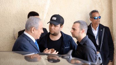 Israel Prime Minister Benjamin Netanyahu speaks with adviser Aaron Klein (right). Photo courtesy of Likud Party.