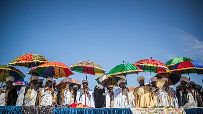 Members of the Ethiopian Jewish community in Israel take part in prayer on the Sigd holiday at the Armon Hanatziv Promenade overlooking Jerusalem on Nov. 16, 2017. Photo by Yonatan Sindel/Flash90.