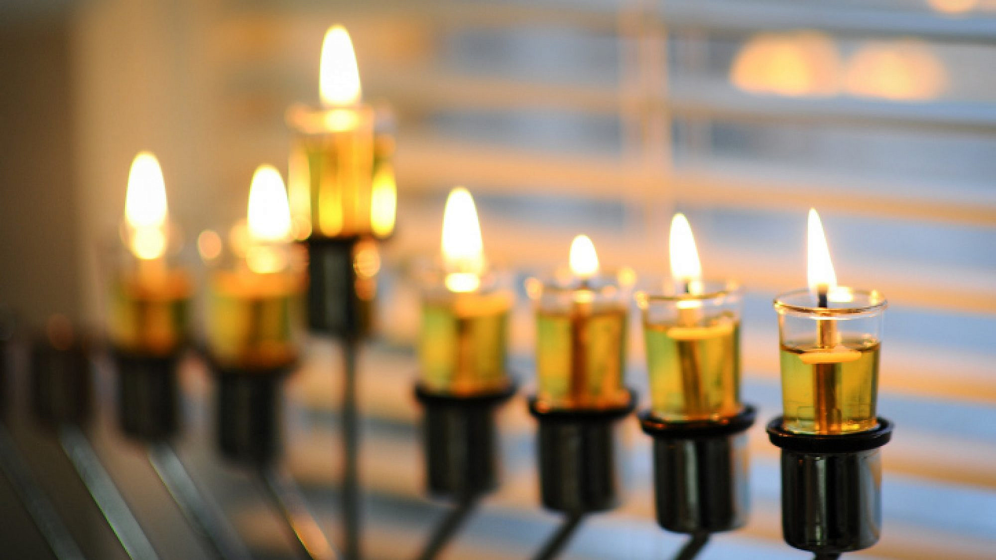 Illustration of a lit menorah on the sixth night of the Jewish holiday of Hanukkah. Photo by Mendy Hechtman/Flash90.