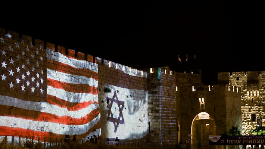 The Israeli and the American flags are screened on the walls of Jerusalem's Old City, on May 14, 2019. Photo by Aharon Krohn/Flash90.