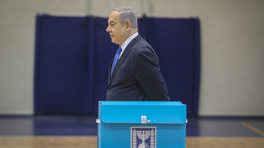 Israeli Prime Minister Benjamin Netanyahu casts his ballot at a voting station in Jerusalem on March 2, 2020. Photo by Marc Israel Sellem/POOL.