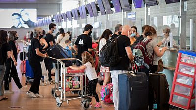 Passengers at Ben Gurion International Airport on Sept. 24, 2020, during a nationwide lockdown due to the COVID-19 pandemic. Photo by Avshalom Sassoni/Flash90.