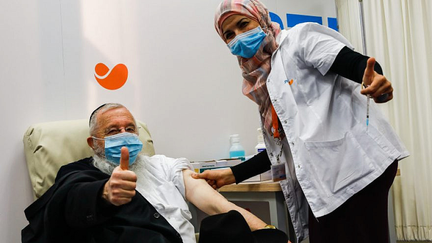 An Israeli receives a COVID-19 vaccine in Jerusalem on Dec. 21, 2020. Photo by Olivier Fitoussi/Flash90.