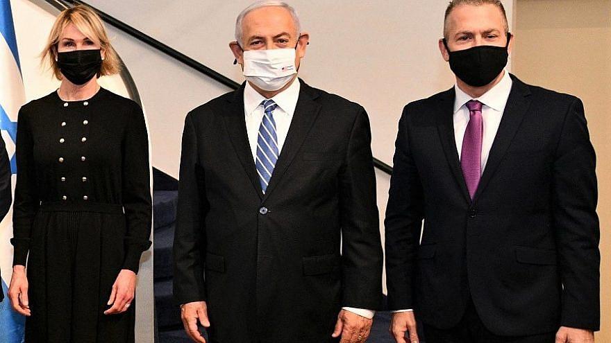 Israeli Prime Minister Benjamin Netanyahu is flanked by U.S. Ambassador to the United Nations Kelly Craft and Israeli Ambassador to the United Nations Gilad Erdan at the Prime Minister's Residence in Jerusalem on Dec. 24, 2020. Credit: Haim Zach/GPO.