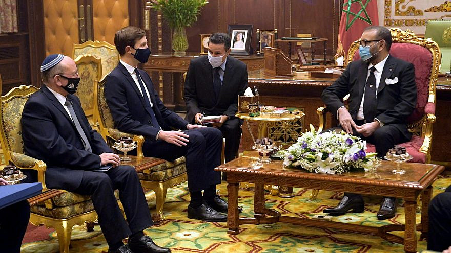 Israel's National Security Adviser Meir Ben-Shabbat (center) and senior adviser to the U.S. president Jared Kushner with Moroccan King Mohammed VI at the royal palace in Rabat, Dec. 22, 2020. Credit: Amos Ben-Gershom/GPO.