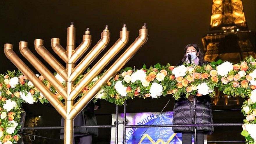 The world-famous Eiffel Tower menorah-lighting took place this year amid the coronavirus pandemic thanks to a last-minute request by Paris Mayor Anne Hidalgo, Dec. 14, 2020. Photo by Thierry Guez via Chabad.org/News.