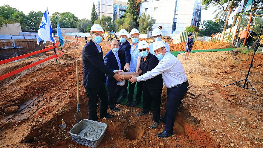 Bar-Ilan University President Prof. Arie Zaban, Roger Grass, and university administrators bury the time capsule at the site of the future Alexander Grass Computer Science Building