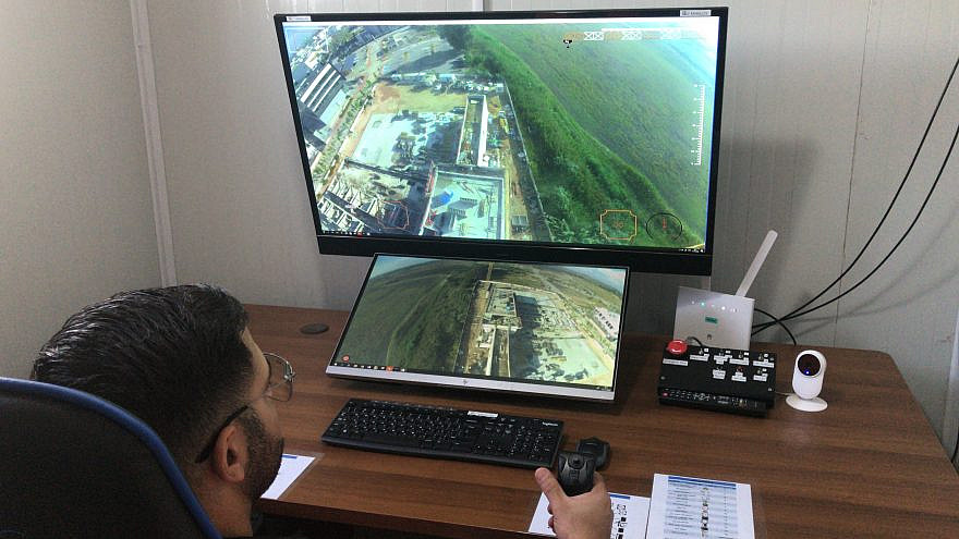 Technology transforms a tower crane operator's booth into a cockpit that resembles an aircraft cabin and is active at a construction site in Israel. Credit: UltraWis.