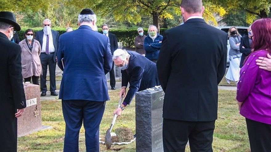 Members of the Jewish community in South Carolina gathered to honor the nameless victims, who perished in Dachau. Photo by Allen Wallace/Chabad.org.News.