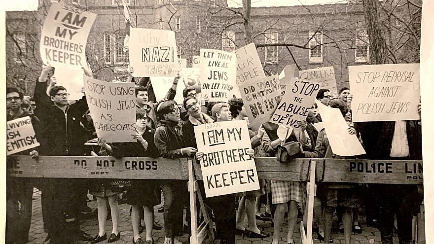 "American-born Israeli author and journalist Yossi Klein Halevi holds ""I Am My Brothers Keeper"" sign circa 1970. Credit: Courtesy."