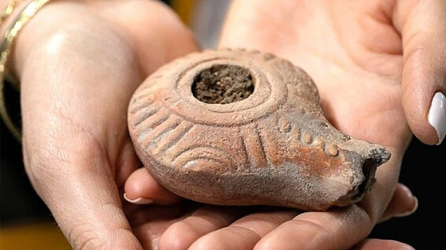The 2,000-year-old candle-holder unearthed in the City of David in Jerusalem, December 2020. Credit: Koby Harati/City of David archives.