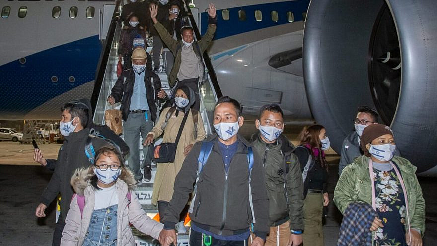New immigrants from the Bnei Menashe community step off the plane at Israel's Ben-Gurion International Airport, Dec. 2020. Credit: Eleonora Shiluv/Ministry of Aliyah and Integration.