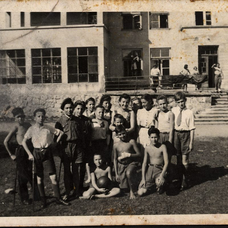 Lena Küchler (center), director of the children's home in Zakopane, Poland, with the children and staff in 1945. Credit: Yad Vashem.