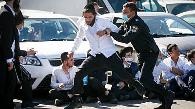 Religious students in Ashdod clash with police as they protest after authorities closed a yeshivah, on Jan. 24, 2021. Photo by Flash90.