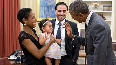 President Barack Obama exchanges a wave with Alya Dorelien Bitar, one-year-old daughter of Maher Bitar, the outgoing National Security Council Director for Israeli and Palestinian Affairs, and his wife, Astrid Dorelien, during a family photo in the Oval Office, Sept. 21, 2015. Photo: Pete Souza/White House.