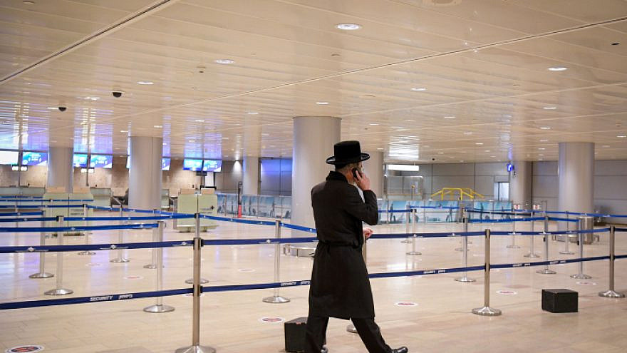 A lone traveler at the almost empty Ben-Gurion International Airport on Jan. 24, 2021. Photo by Flash90.