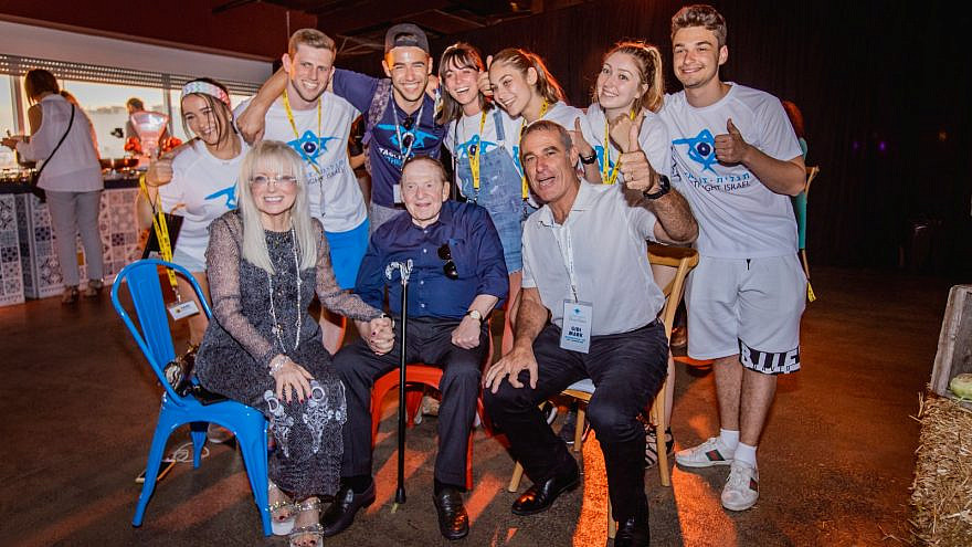 Sheldon and Dr. Miriam Adelson with a Taglit-Birthright group. Credit: Courtesy.