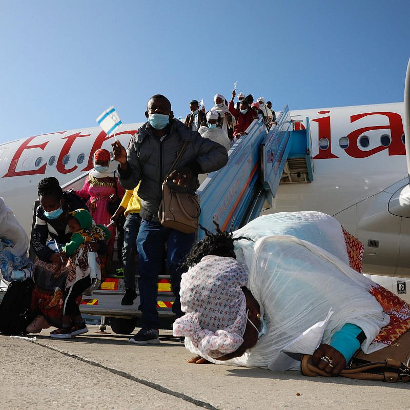 "Ethiopian immigrants to Israel, part ""Operation Tzur Israel"" (""Rock of Israel""), after exiting the plane at Ben-Gurion International Airport on Dec. 3, 2020. Credit: Olivier Fitoussi, Courtesy of the Jewish Agency for Israel."