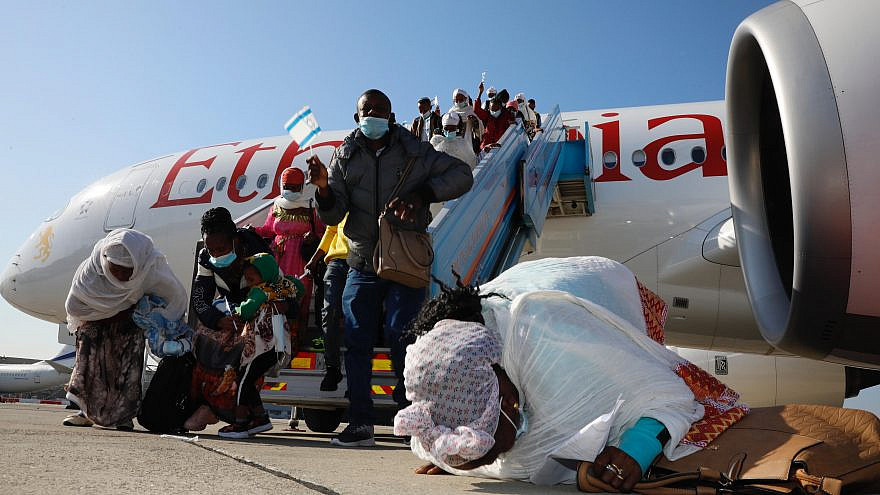 """Ethiopian immigrants to Israel, part of """"Operation Tzur Israel"""" (""""Rock of Israel""""), after exiting the plane at Ben-Gurion International Airport on Dec. 3, 2020. Credit: Olivier Fitoussi/The Jewish Agency for Israel."""