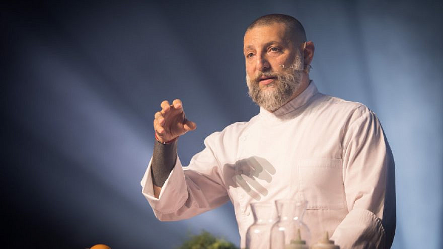 Israeli chef Assaf Granit speaks at a conference with science ministers from around the world in Jerusalem on May 2, 2018. Photo by Yonatan Sindel/Flash90.