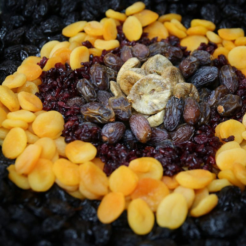 A table in northern Israel with fruits and nuts, traditionally eaten on Tu B'Shevat. Feb. 9, 2020. Photo by David Cohen/Flash90.