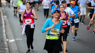 Runners take part in the Tel Aviv marathon pre-global pandemic on Feb. 28, 2020. Photo by Avshalom Sassoni/Flash90.