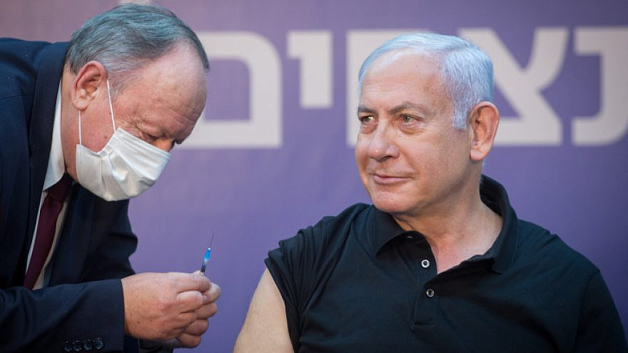 Israeli Prime Minister Benjamin Netanyahu receives the second does of Pfizer's COVID-19 vaccine at the Sheba Medical Center at Tel HaShomer outside of Tel Aviv, on Jan. 9, 2021. Photo by Miriam Alster/Flash90.