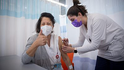 A staff member receives a second dose of Pfizer's BioNTech COVID-19 vaccine at the Sheba Medical Center at Tel HaShomer, on Jan. 10, 2021. Photo by Miriam Alster/Flash90.
