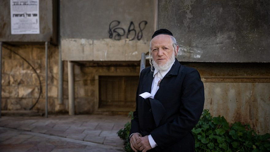 Yehuda Meshi Zahav, chairman of Israel's ZAKA rescue unit outside sitting shivah for his mother in the ultra-Orthodox neighborhood of Mea Shearim in Jerusalem, Jan. 19, 2021. Photo by Yonatan Sindel/Flash90.
