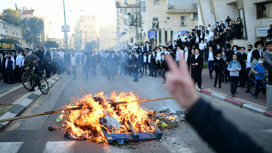 Israeli police clash with ultra-Orthodox Jews during a protest against police enforcement of the country's COVID-19 lockdown in the city of Bnei Brak, Jan. 24, 2021. Photo by Tomer Neuberg/Flash90.