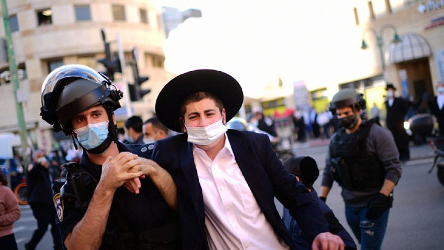 Israeli police clash with haredi Jews during a protest against the police enforcement of lockdown orders due to the coronavirus, in the city of Bnei Brak on Jan. 24, 2021. Photo by Tomer Neuberg/Flash90.