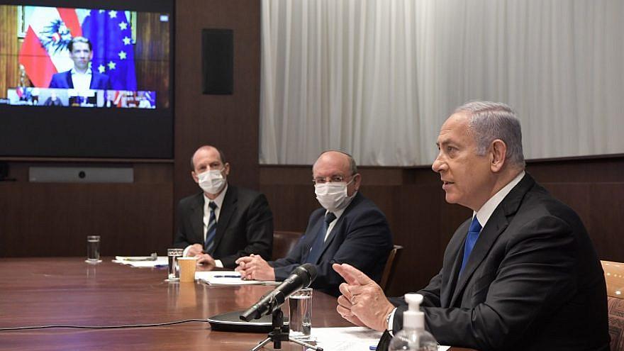 Israeli Prime Minister Benjamin Netanyahu in a video conference with world leaders on Jan. 18, 2021. Credit: Kobi Gideon/GPO.