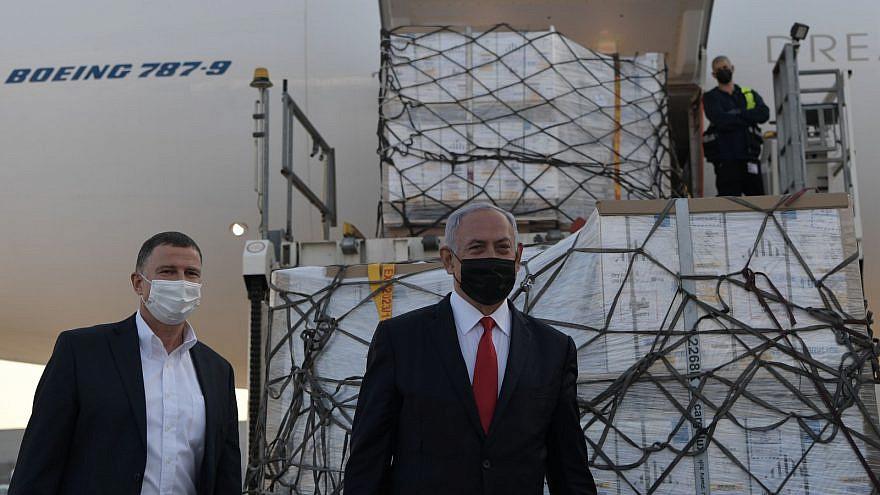 Israeli Prime Minister Benjamin Netanyahu and Health Minister Yuli Edelstein welcome a vaccine shipment at Ben-Gurion International Airport, on Jan. 10, 2021. Credit: Koby Gideon/GPO.