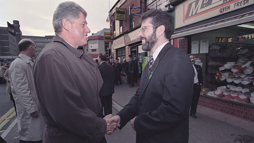 Former President Bill Clinton greets Gerry Adams in East Belfast, Nov. 30, 1995. Credit: White House Photo by Sharon Farmer via Wikimedia Commons.