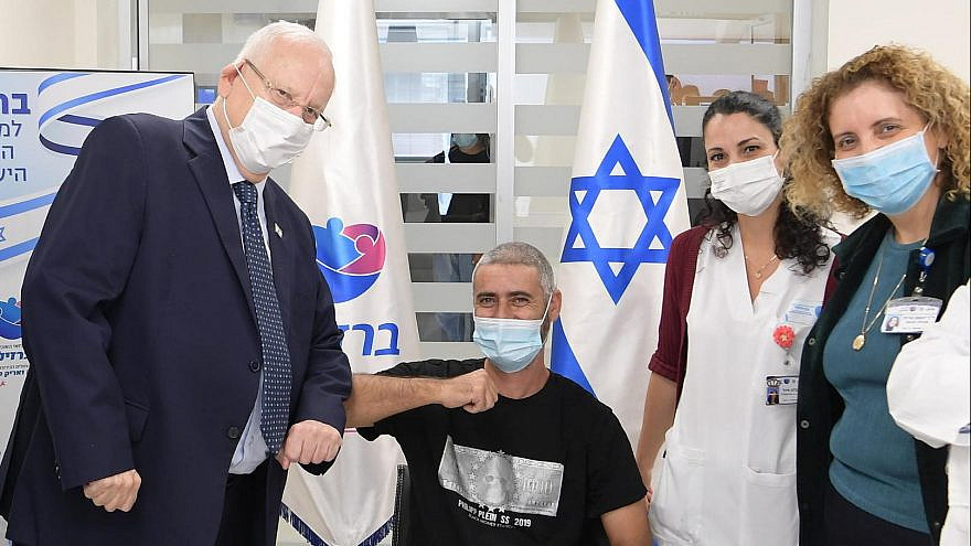 Israeli President Reuven Rivlin (left) meets the first person to receive Israel's Brilife COVID-19 vaccine, as part of the expanded phase II trials, at Barzilai Medical Center in Ashkelon, on Jan 5, 2021. Photo: Amos Ben-Gershom/GPO.