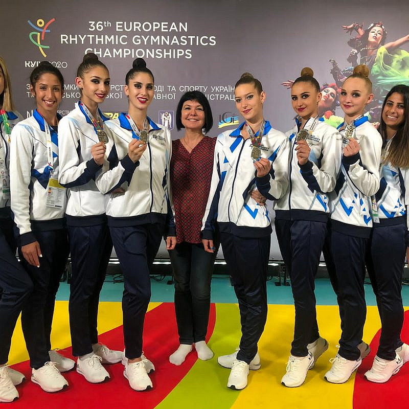 Coach Ira Vigdorchik (center) surrounded by Israel's rythmic gymnastics team. Credit: Courtesy.
