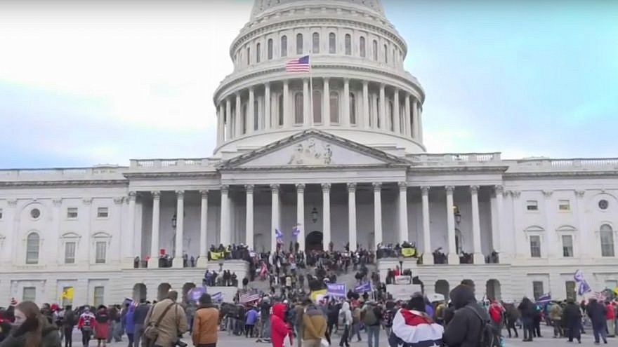 Supporters of U.S. President Donald Trump at the U.S. Capitol, where some smashed windows and entered the building while protesting the results of the November elections. Jan. 6, 2020. Source: YouTube/Screenshot.