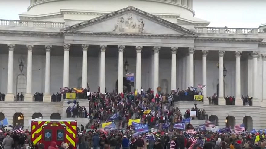 Supporters of President Donald Trump at the U.S. Capitol, where hundreds smashed windows and broke into the building while protesting the results of the November elections, Jan. 6, 2021. Source: YouTube.
