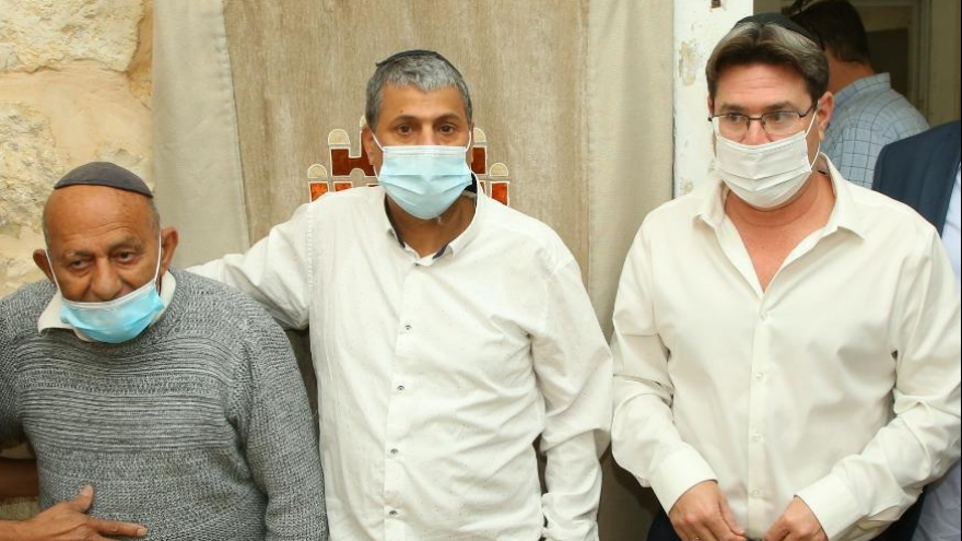 From left: Rahamim Madmoni, (left) the son of Shlomo Madmoni, who was slain during the 1939 Arab riots while attempting to rescue a Torah scroll and other synagogue property, with Shiloah public council head Gadi Bashari and Israeli Minister of Regional Cooperation Ofir Akunis.