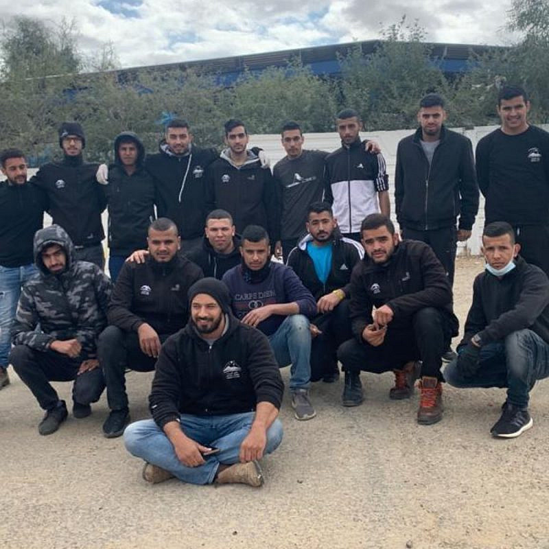The Bedouin volunteers who fixed up a vandalized Jewish graveyard in the Negev. At left, in white, is Yochai, the cemetery's caretaker. Photo courtesy of Desert Stars.