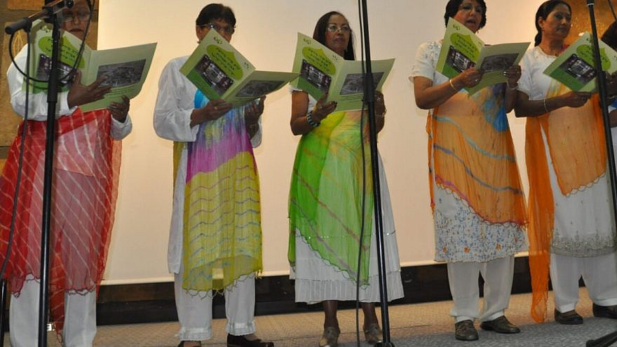 Women from the Cochin Jewish community perform on stage during a culture event at Bar-Ilan University. Photo by Victor Yitzhak, Cochin Jewish Heritage Center.