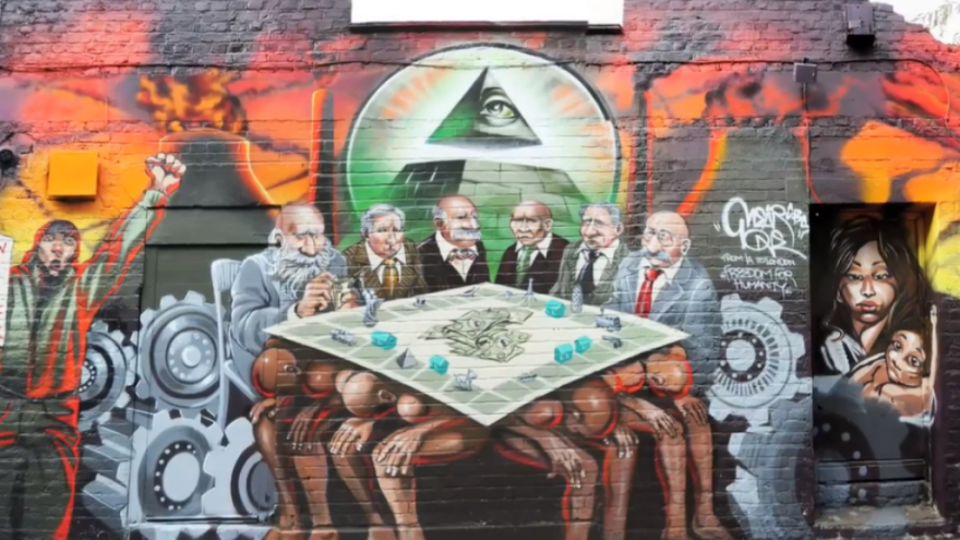 """A view of the anti-Semitism """"Freedom for Humanity"""" mural in London that was taken down in 2012. Source: Screenshot."""
