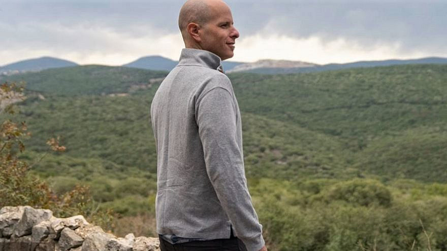 Dor Pintel, an Israeli tour guide who found roots in an agricultural and food venture with a friend since travel has been virtually nil since the start of the coronavirus, looks out over the Galilee, Februay 2021. Credit: JNF-USA.