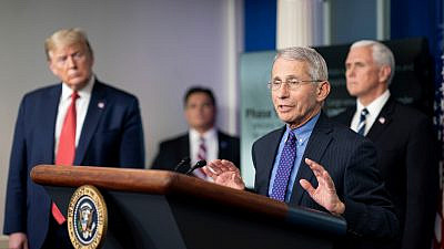 Former President Donald Trump, joined by Vice President Mike Pence, listen as director of the National Institute of Allergy and Infectious Diseases Dr. Anthony Fauci delivers remarks during a coronavirus update briefing on April 16, 2020, in the James S. Brady Press Briefing Room of the White House. Credit: Official White House Photo by Andrea Hanks.