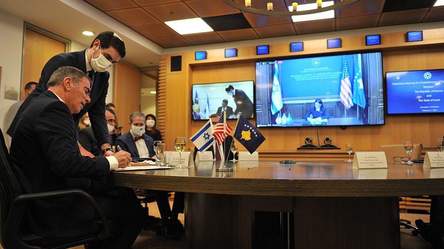 Israel's Foreign Minister Gabi Ashkenazi and Kosovo Foreign Minister Meliza Haradinaj-Stublla sign an agreement establishing diplomatic relations between the two countries on Feb. 1, 2021. Source: Gabi Ashkenazi/Twitter.