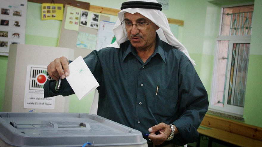A Palestinian casts his vote in the municipal elections in the West Bank town of Al-Bireh on Oct. 20, 2012. Photo by Issam Rimawi/Flash90.