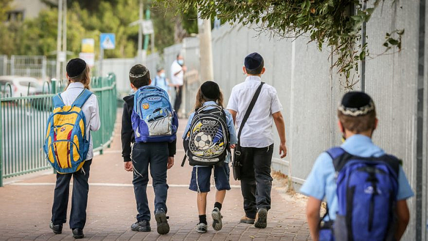 Israeli children wearing face masks make their way to school in Tzfat on their first day back to classes on Nov. 1, 2020. Photo by David Cohen/Flash90.