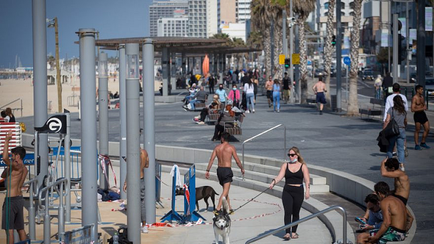 Israelis at the beach in Tel Aviv as Israel exits its third COVID-19 lockdown, Feb. 7. 2021. Photo by Miriam Alster/Flash90.