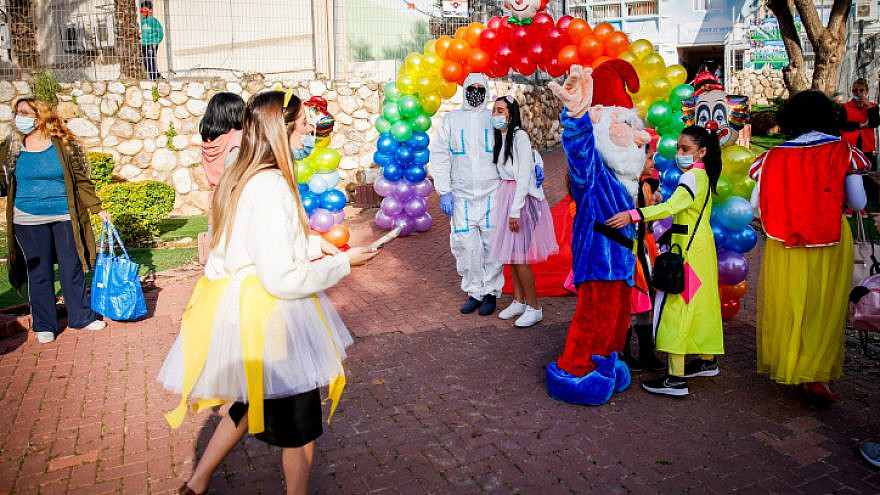 Israeli children dressed in costume arrive at school in Sderot ahead of the Purim holiday, Feb. 24, 2021. Photo by Flash90.
